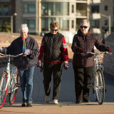 older_women_walking_with_bikes_bike-ped_pfluger_bridge_austin