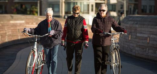 older_women_walking_with_bikes_bike-ped_pfluger_bridge_austin