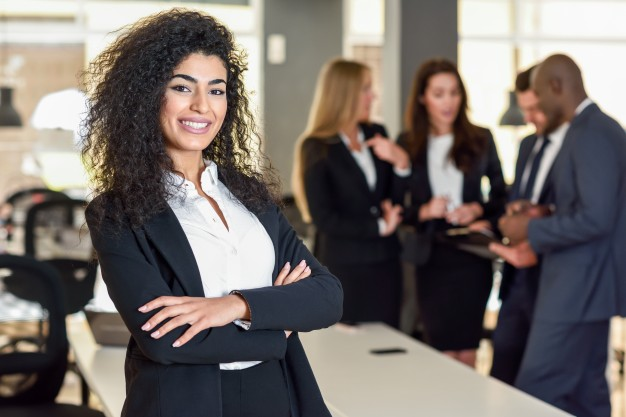 businesswoman-leader-in-modern-office-with-businesspeople-workin_1139-958
